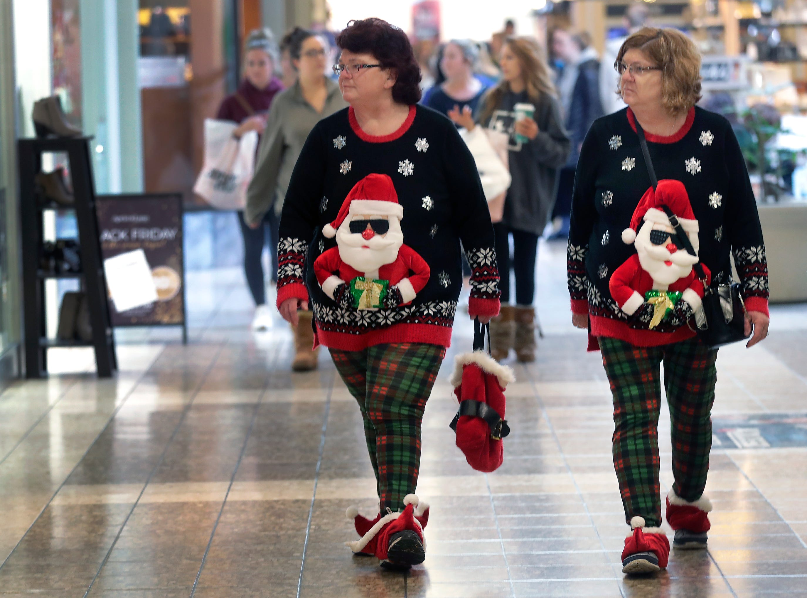 Teresa Black, left, and Alice Keel are dressed for the hoildays while shopping on Black Friday at the Fox River Mall on Nov. 23, 2018 in Grand Chute, Wisc.