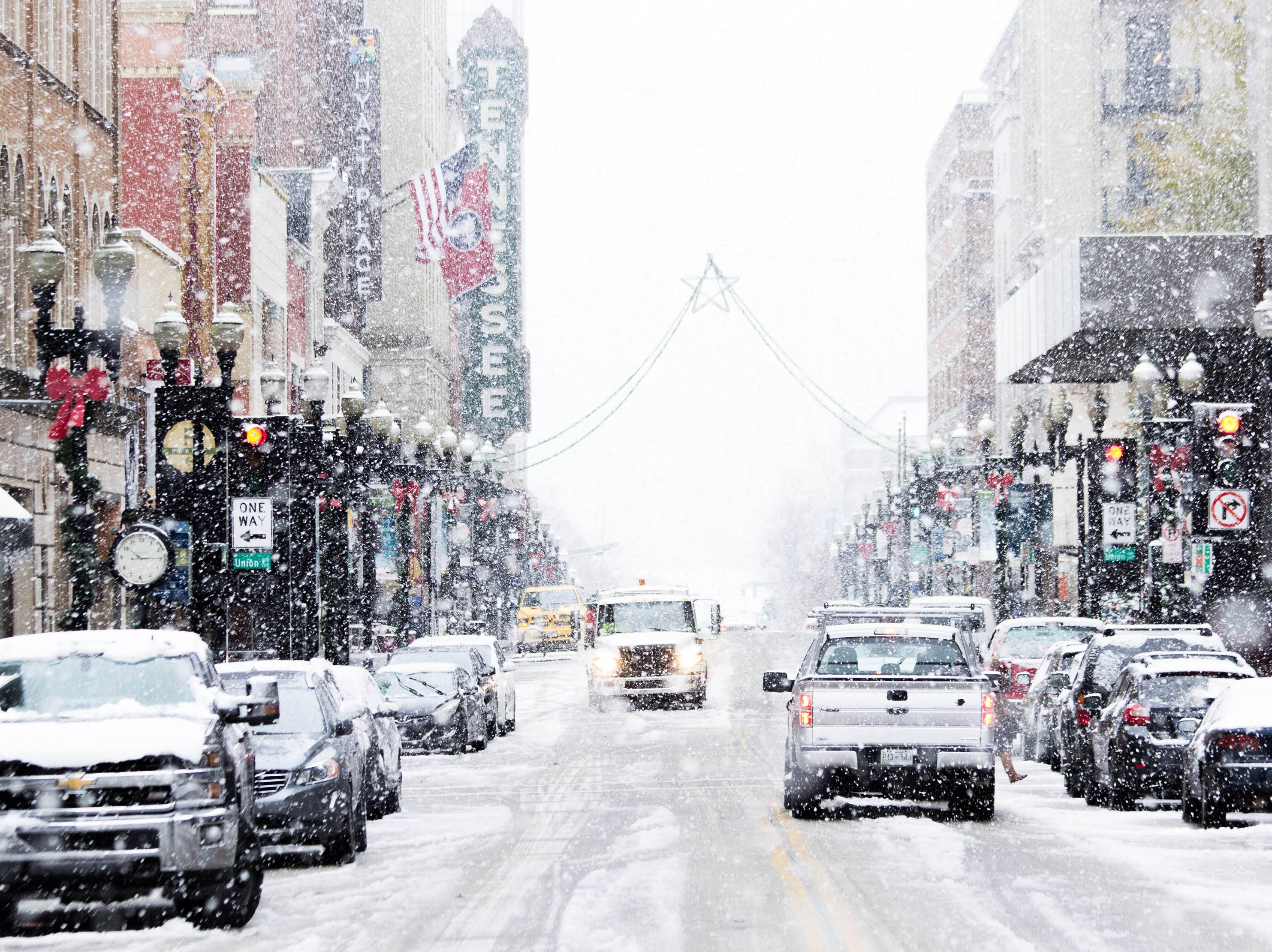 Snow flurries fall on Gay St. on Dec. 9, 2018 as Knoxville, Tenn. receives the season's first snow fall.