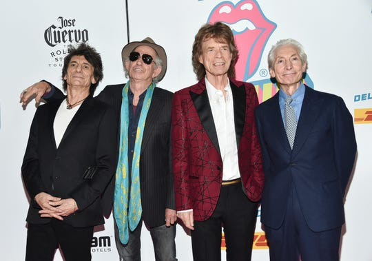 """FILE - In this Nov. 15, 2016 file photo, The Rolling Stones, from left, Ronnie Wood, Keith Richards, Mick Jagger and Charlie Watts attend the opening night party for """"Exhibitionism"""" in New York. The Rolling Stones will be rolling through the U.S. next year. The band says it is adding a 13-show leg to its No Filter tour in spring 2019, kicking off in Miami on April 20. (Photo by Evan Agostini/Invision/AP) ORG XMIT: NYET156"""