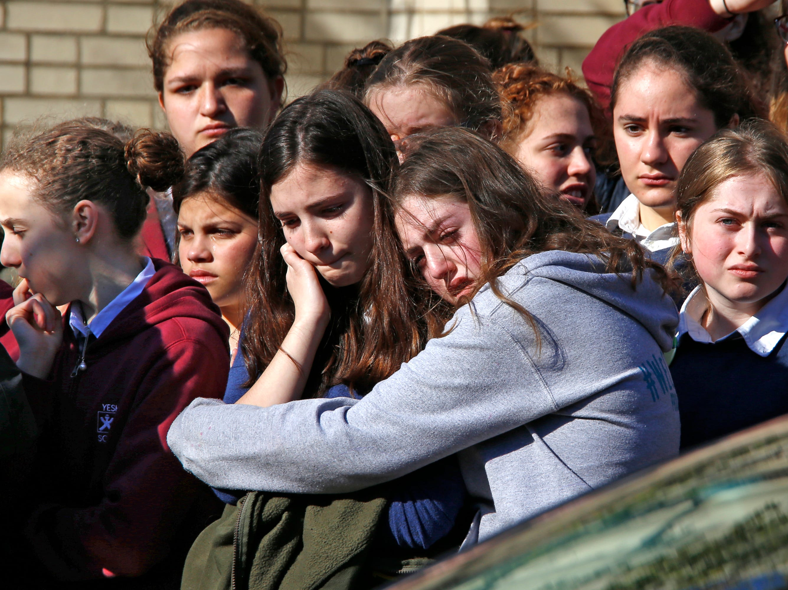 Students from the Yeshiva School in the Squirrel Hill neighborhood of Pittsburgh stand outside Beth Shalom Synagogue after attending the funeral service for Joyce Fienberg, Oct. 31, 2018. Joyce Fienberg, 75, was one of 11 people killed when a gunman opened fire during worship services at the Tree of Life Synagogue on Oct. 27.