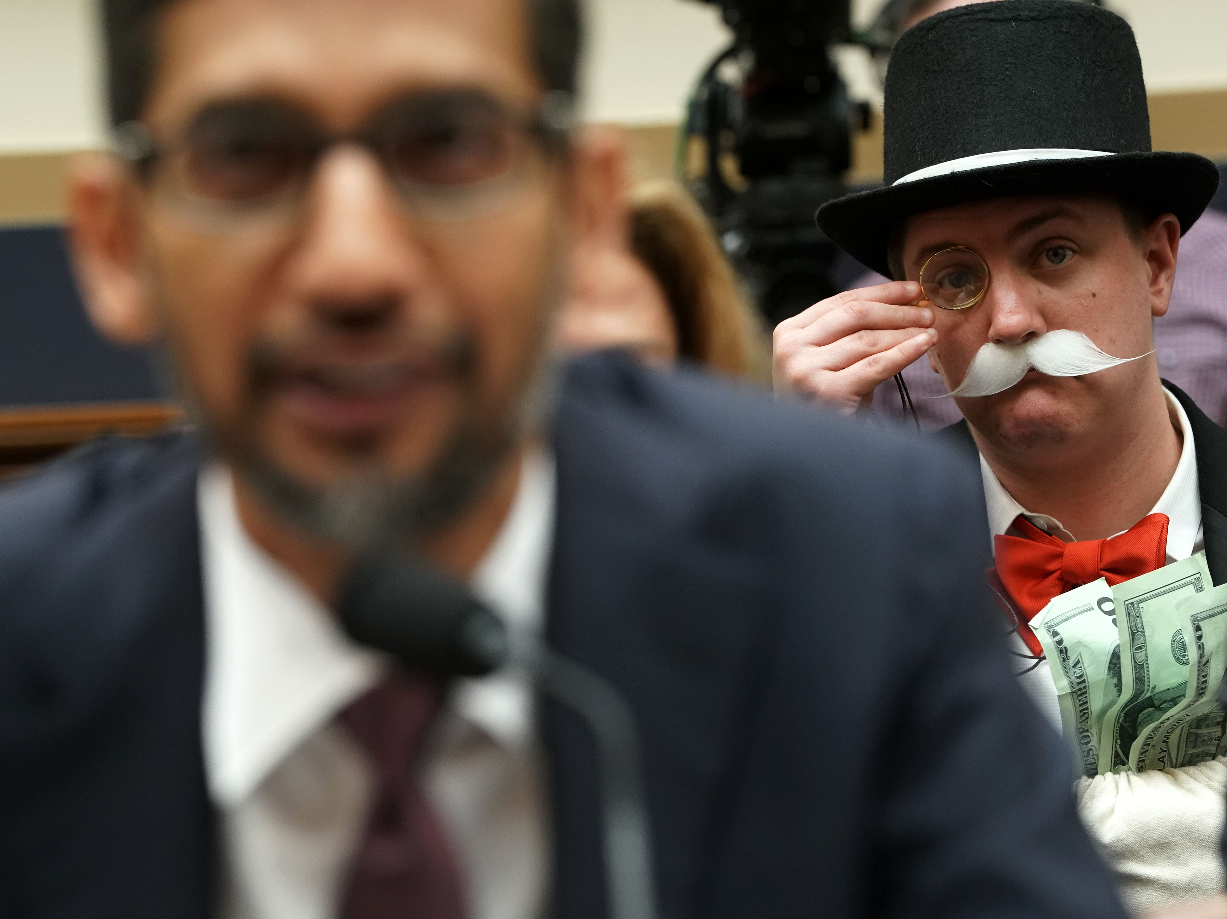 Ian Madrigal (R) dresses as Mr. Monopoly as Google CEO Sundar Pichai (L) testifies before the House Judiciary Committee at the Rayburn House Office Building on Dec. 11, 2018 in Washington, DC. The committee held a hearing on 'Transparency & Accountability: Examining Google and its Data Collection, Use and Filtering Practices.'