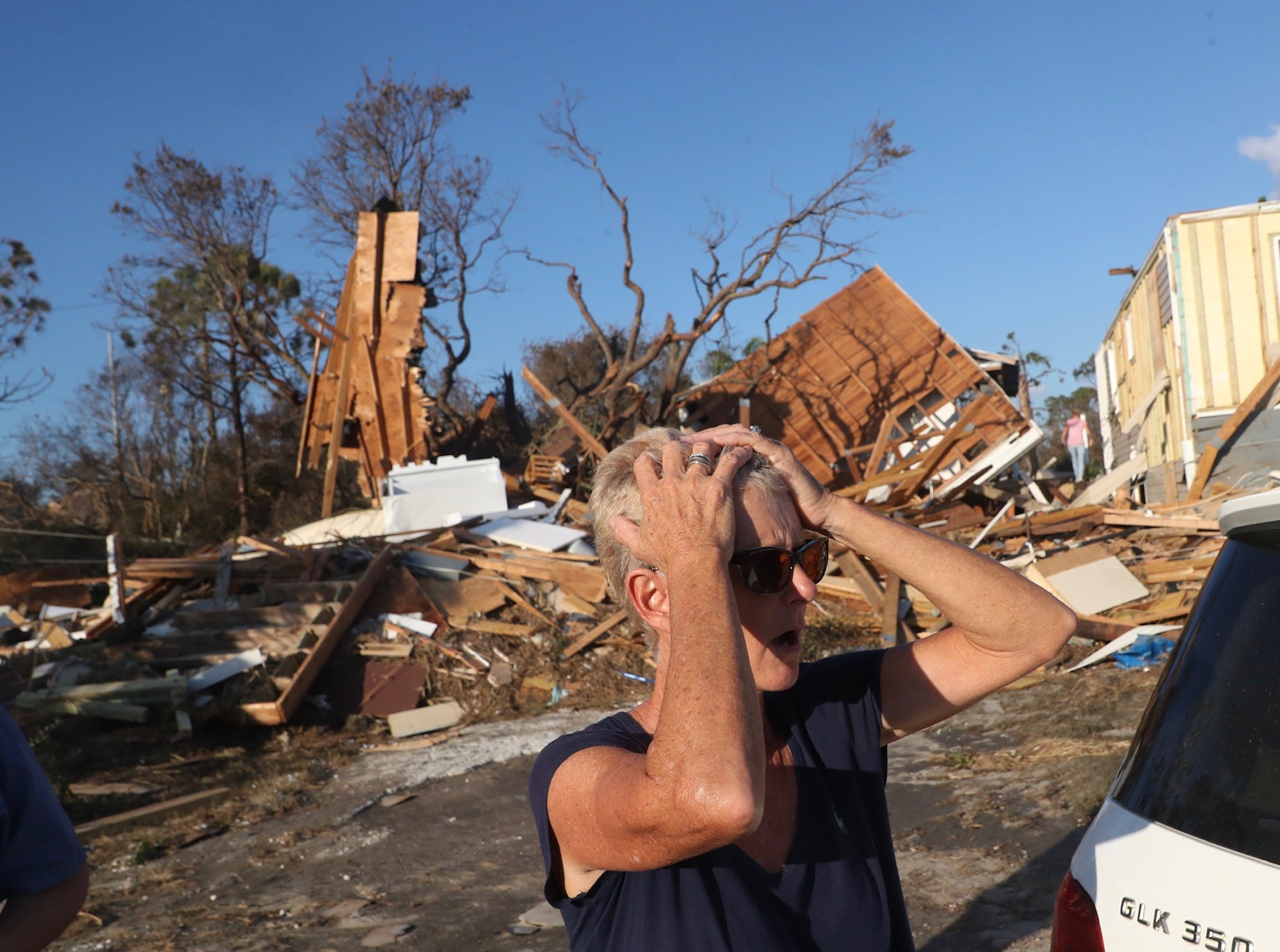 Becky Daniel reacts to seeing her Beacon Hill home, behind her, on Oct. 11, 2018. It was destroyed in Hurricane Michael. The area is right next to Mexico City, Fla. which was ground zero for the hurricane.