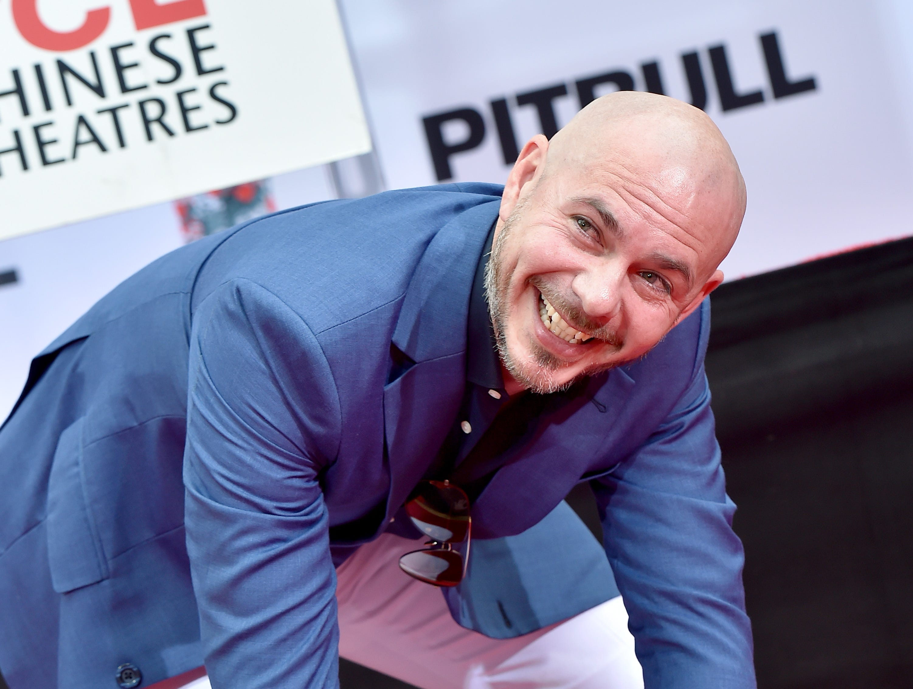 HOLLYWOOD, CA - DECEMBER 14:  Pitbull is honored with Hand and Footprint Ceremony at TCL Chinese Theatre on December 14, 2018 in Hollywood, California.  (Photo by Axelle/Bauer-Griffin/FilmMagic) ORG XMIT: 775269143 ORIG FILE ID: 1073345474