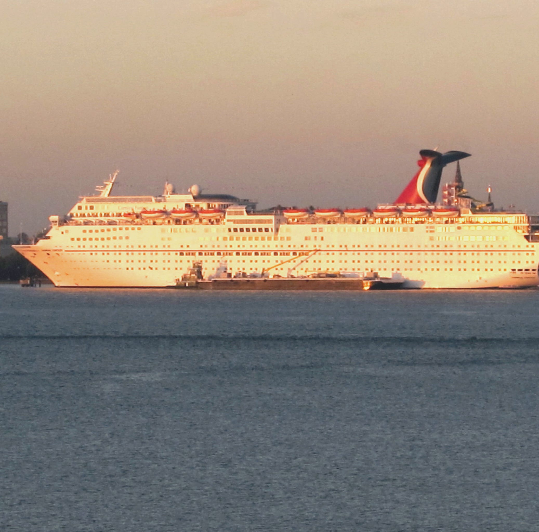 In this Jan. 25, 2012 file  photo, the Carnival Fantasy rests at its berth just after dawn in Charleston, S.C.