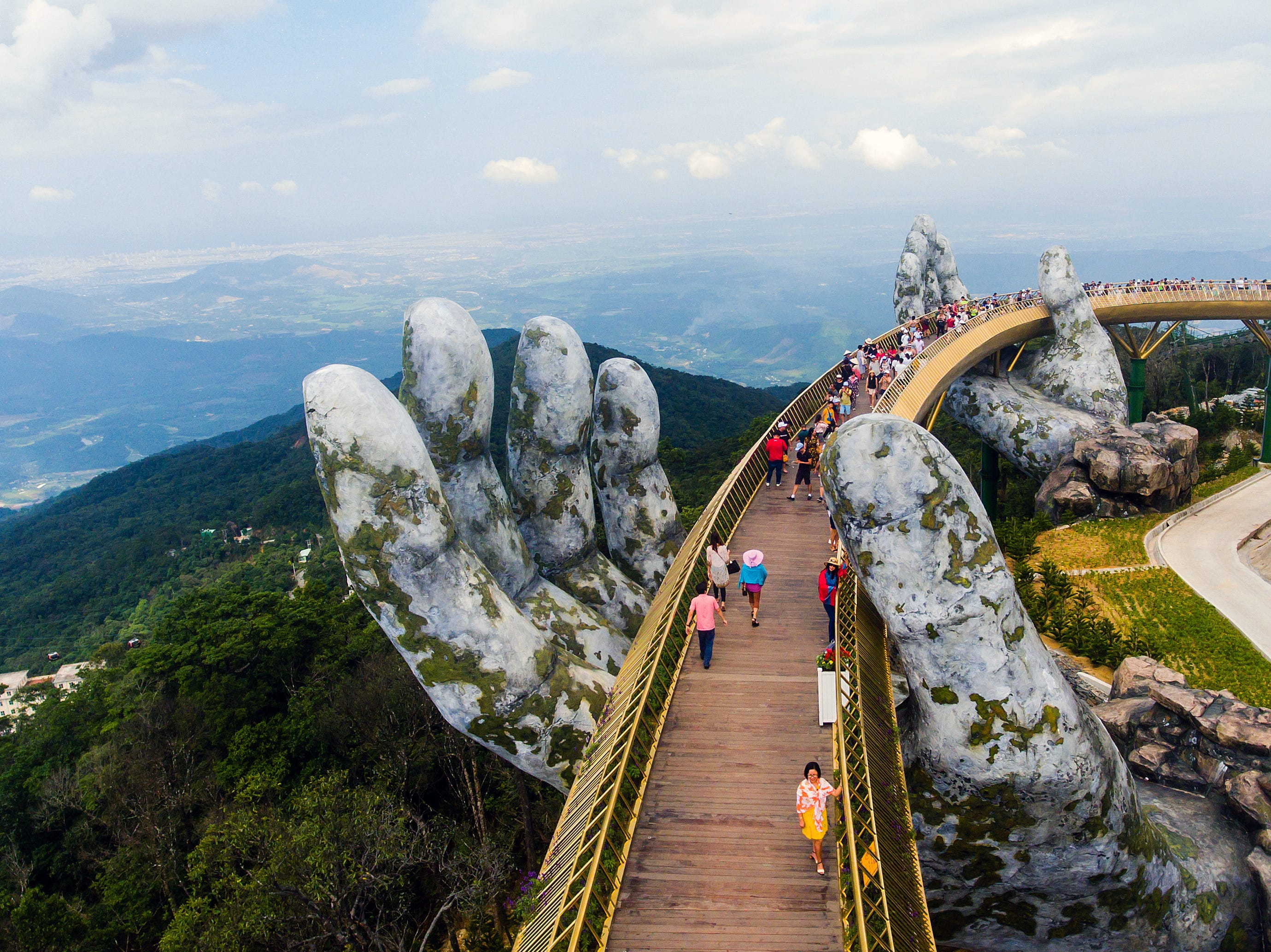 Aug. 3, 2018: A picture taken with a drone shows tourists walking on the newly built Cau Vang, meaning Golden Bridge on Ba Na hills near Da Nang city, Vietnam. The bridge which is more than 1,400m above sea level and stretches 150m long, is reportedly a part of a $2 billion dollar project to attract more visitors to Vietnam.