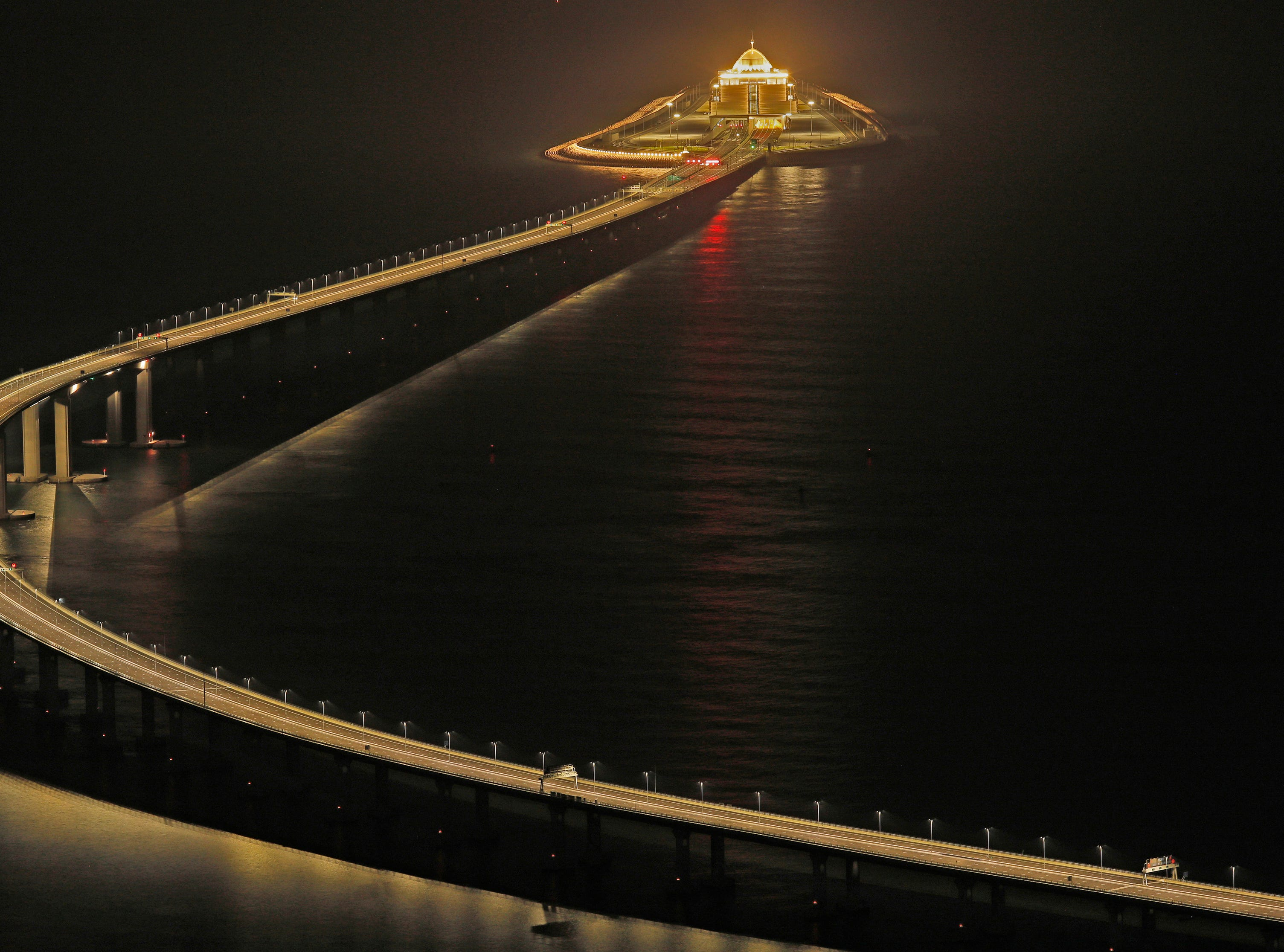 The Hong Kong-Zhuhai-Macau Bridge is lit up in Hong Kong on Oct. 21, 2018. The bridge is the world's longest cross-sea project at 34 miles long and officially opened on Oct. 23.