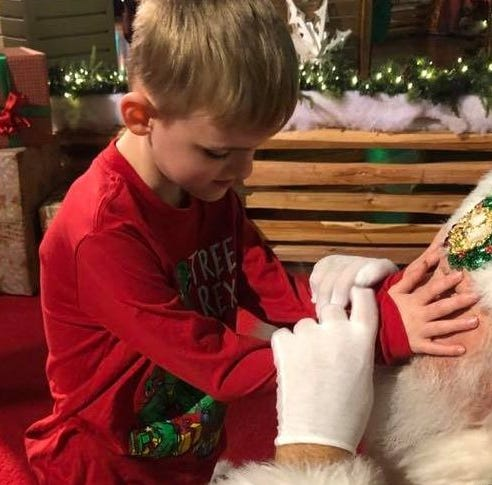 "Matthew Foster, 6, gets his wish to ""see"" Santa's ""eyes that twinkle"""