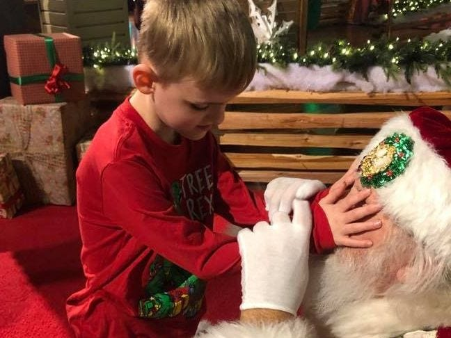 """Matthew Foster, 6, gets his wish to """"see"""" Santa's """"eyes that twinkle"""""""