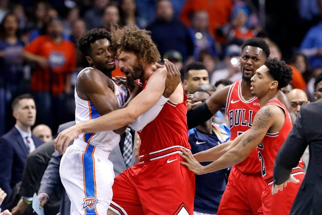 Oklahoma City Thunder forward Jerami Grant, left, and Chicago Bulls center Robin Lopez, right, get into an argument during the second half at Chesapeake Energy Arena. Oklahoma City won 121-96.