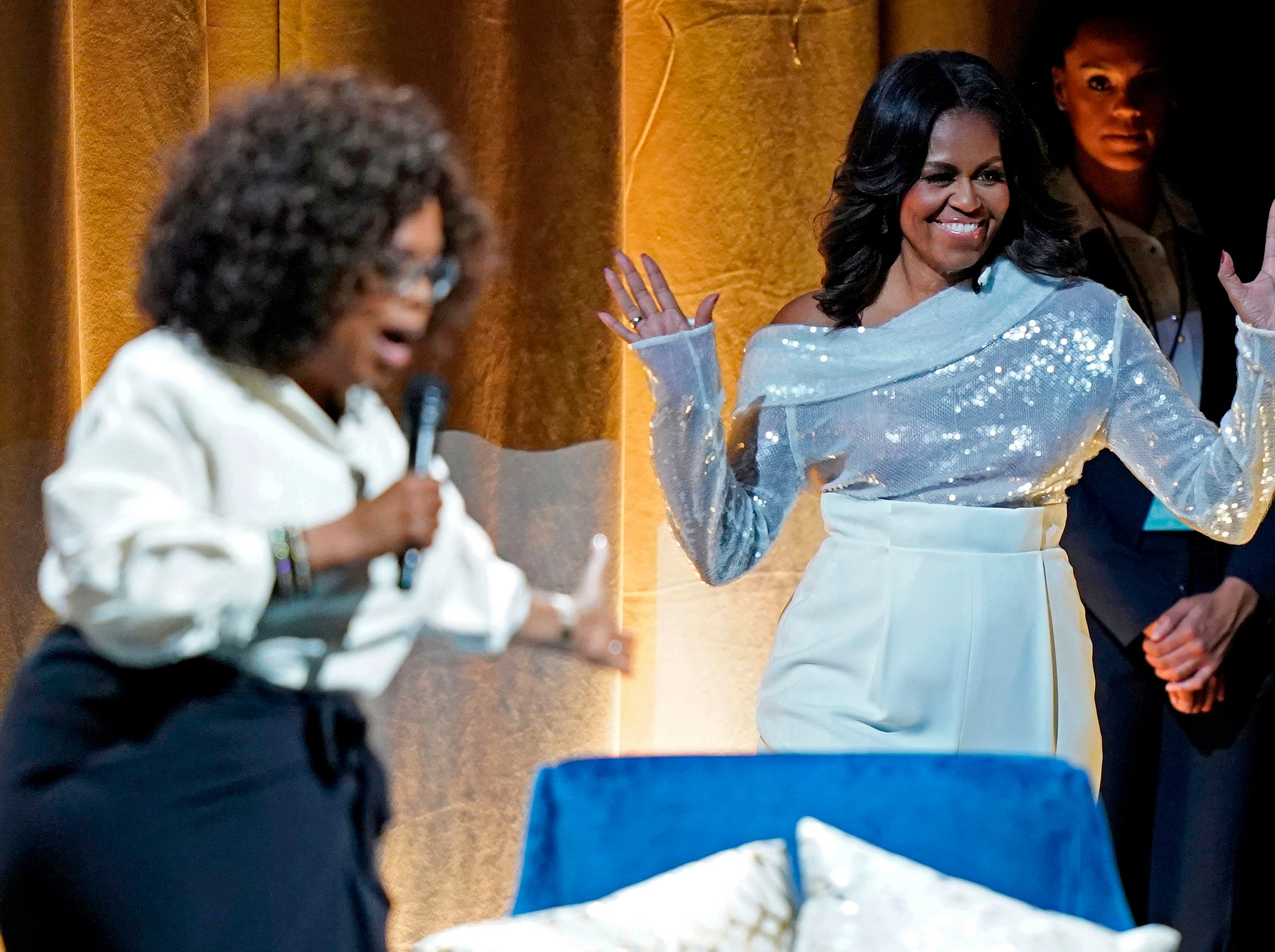 Former first lady Michelle Obama is introduced by Oprah Winfrey at the opening of her multi-city book tour at the United Center in Chicago, November 13, 2018.