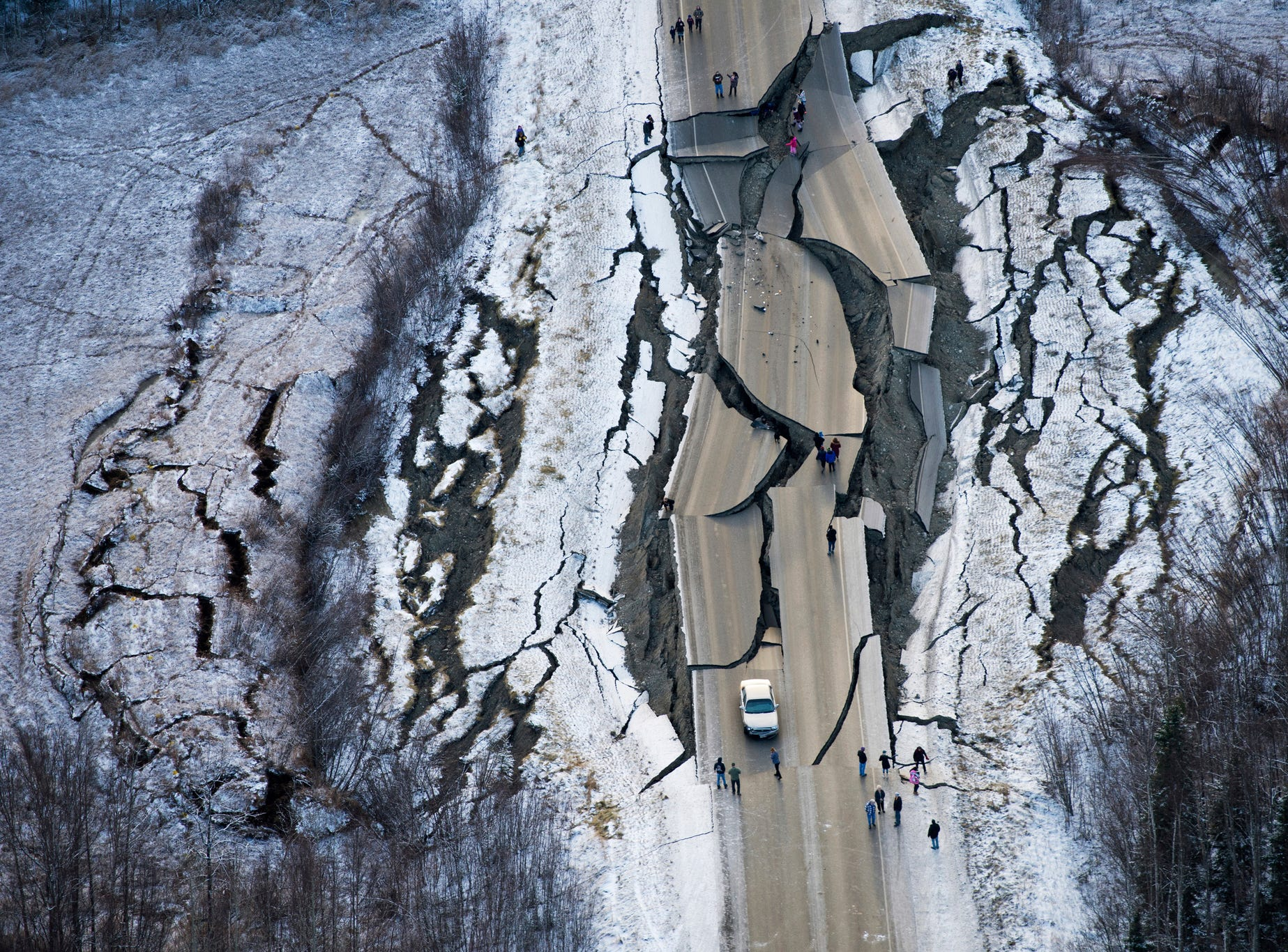 This aerial photo shows damage on Vine Road, south of Wasilla, Alaska, after earthquakes, Nov. 30, 2018. Back-to-back earthquakes measuring 7.0 and 5.7 shattered highways and rocked buildings in Anchorage and the surrounding area, sending people running into the streets and briefly triggering a tsunami warning for islands and coastal areas south of the city.