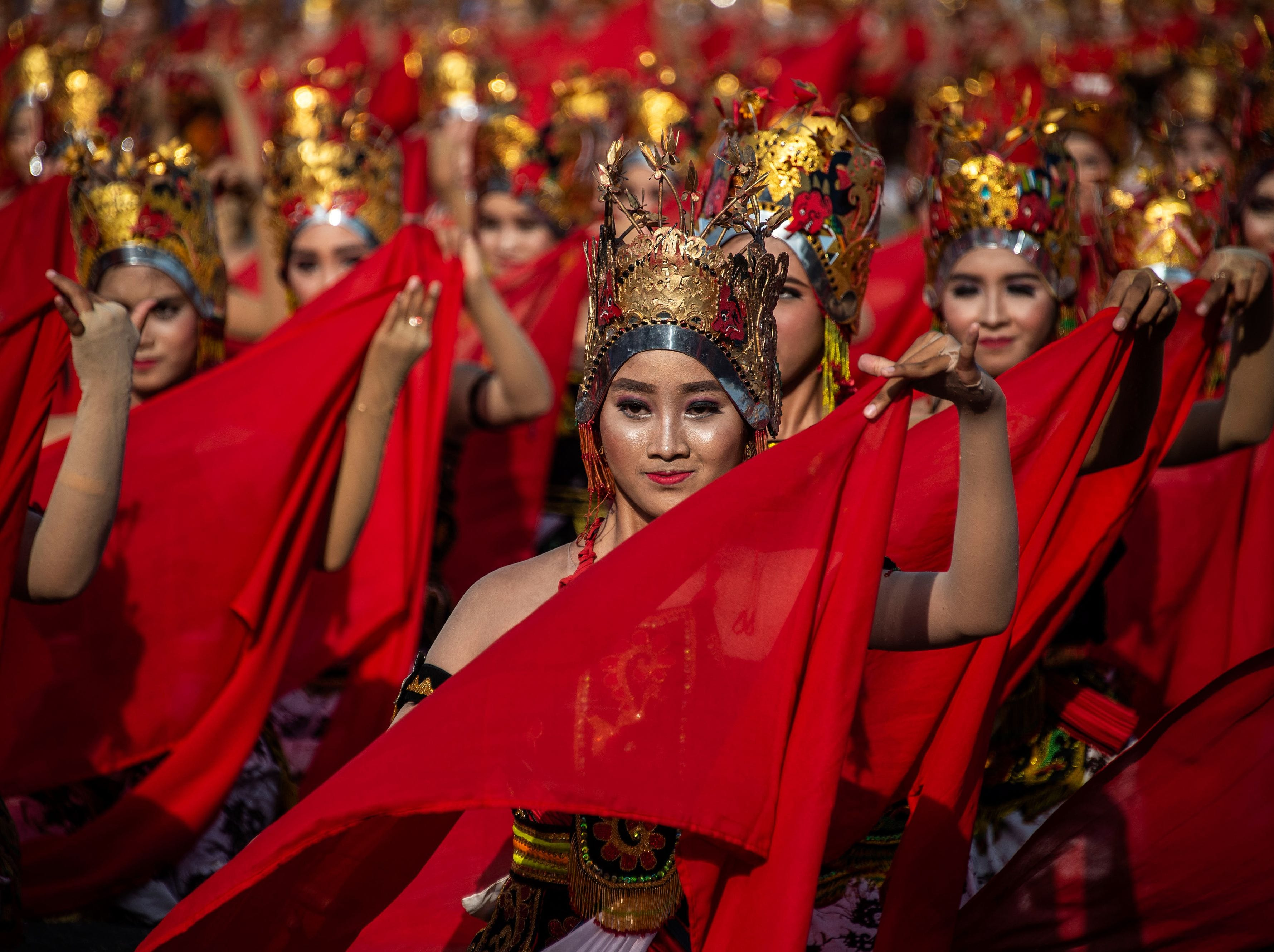 Traditional dancers performing the Gandrung Sewu dance at the festival on Boom beach in Banyuwangi, East Java on Oct. 20, 2018.