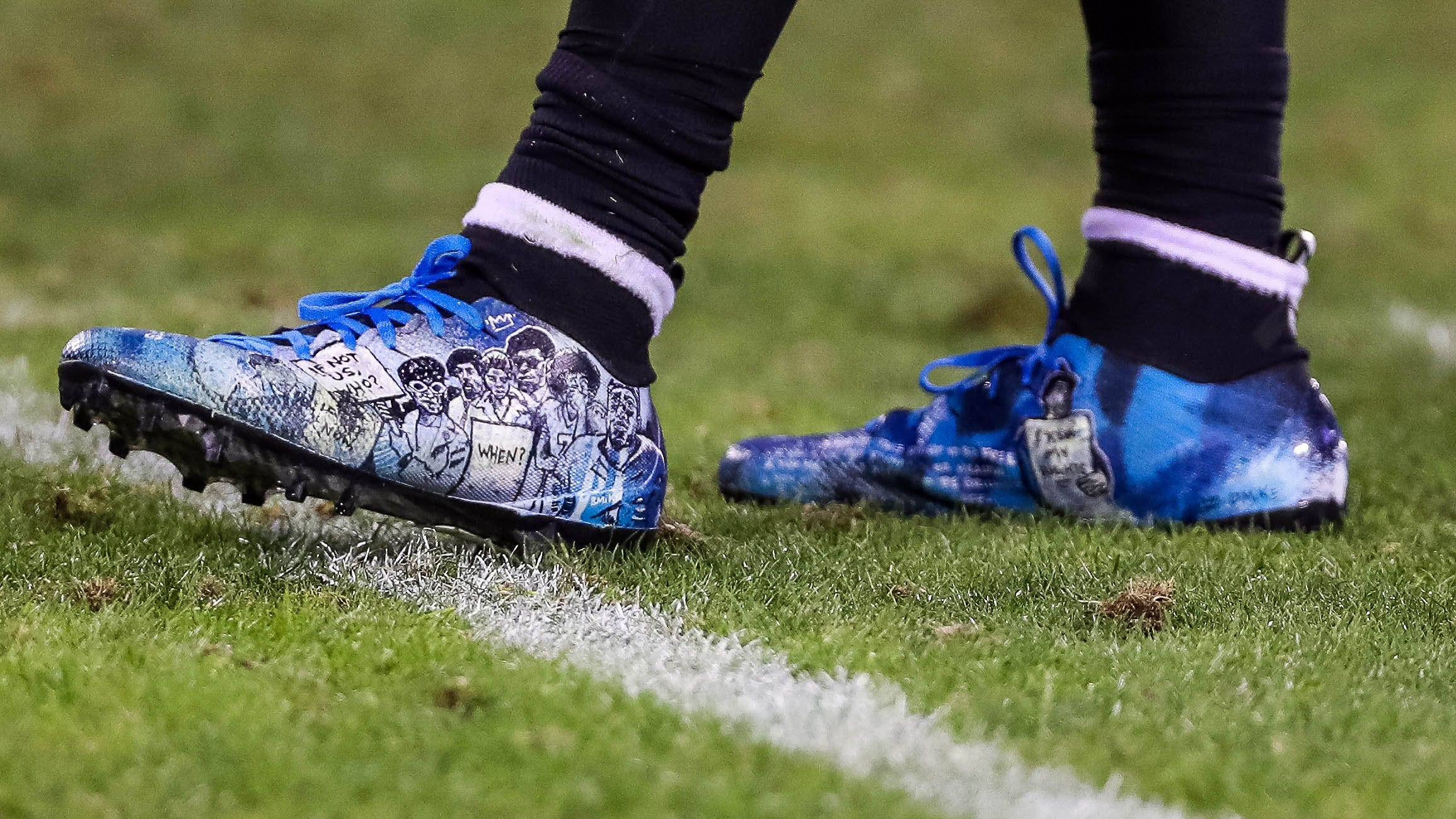 The Panthers' Eric Reid, who had knelt alongside Colin Kaepernick, had artwork of the former 49ers quarterback and other protesters on his cleats.