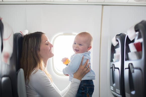 I, too, used to breeze through flights with magazines and movies. Then, I became a mother. Now all my efforts go toward keeping my son's diaper smell contained. That's also why I won't be handing out those cute goody bags to my fellow passengers.