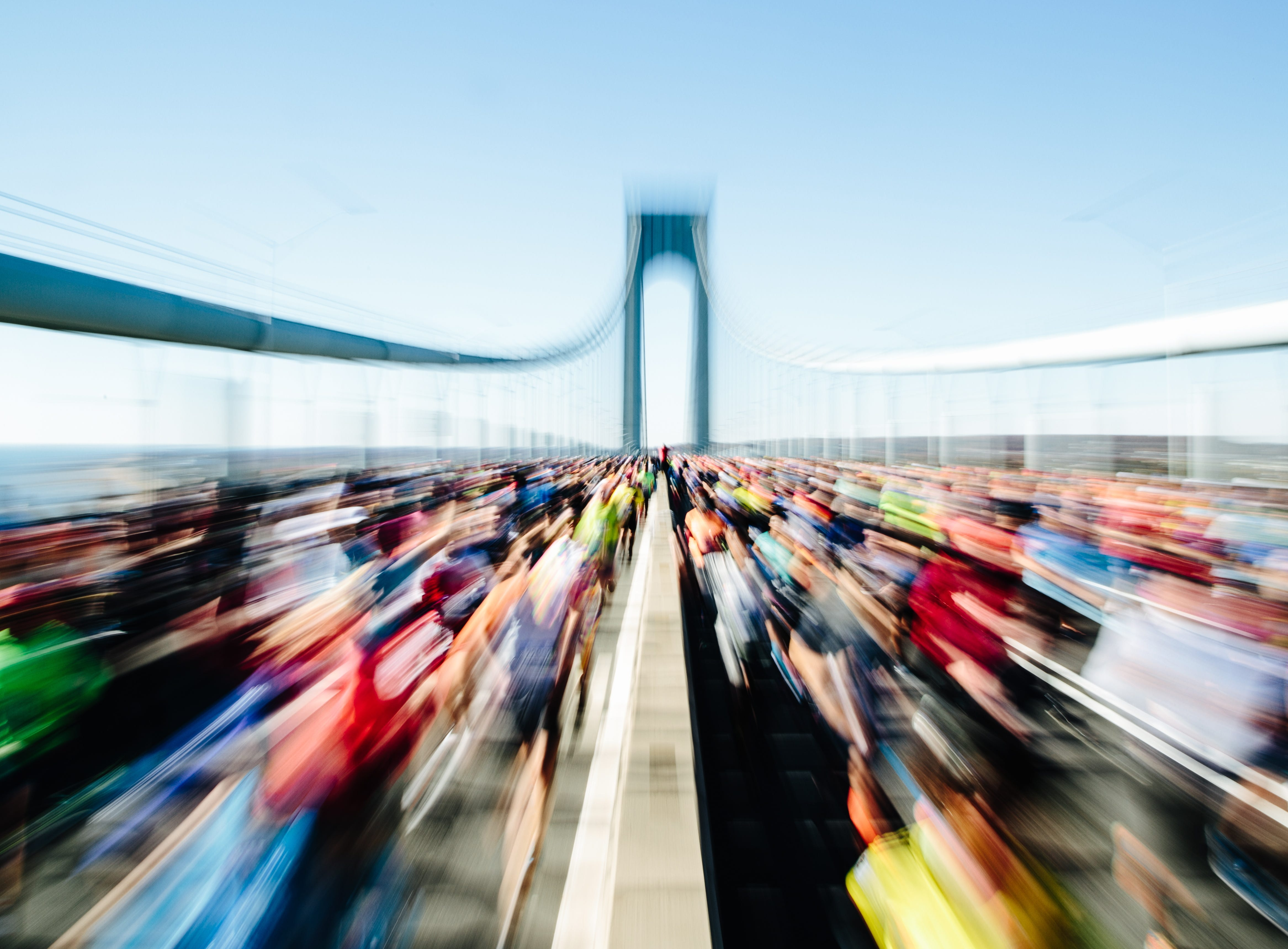 A photo taken with a zoom effect shows runners head across the Verrazano-Narrows Bridge at the start of the New York City Marathon in Staten Island, New York on Nov. 4, 2018.