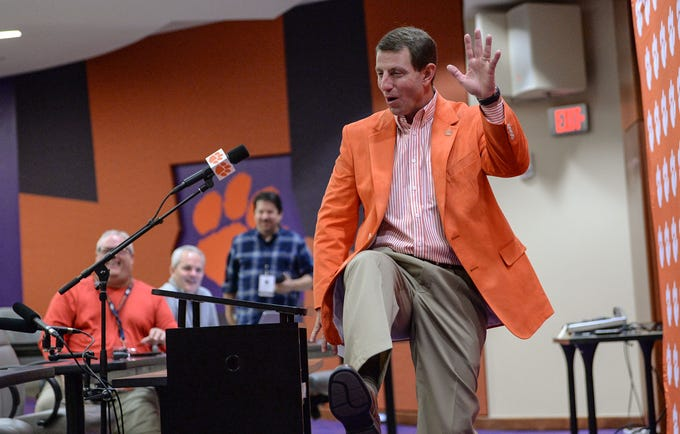 Clemson Head Coach Dabo Swinney talks about a recent recruiting trip to California during a press conference in the West End Zone for early signing day, in Clemson Wednesday.