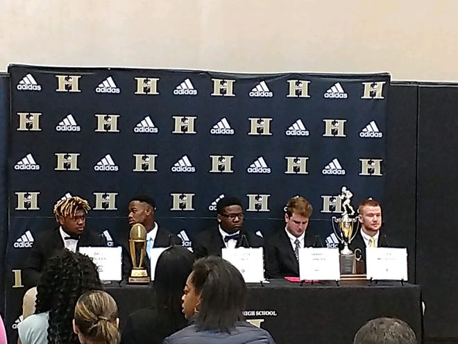 Five T.L. Hanna football players on Wednesday signed to continue their careers in college.