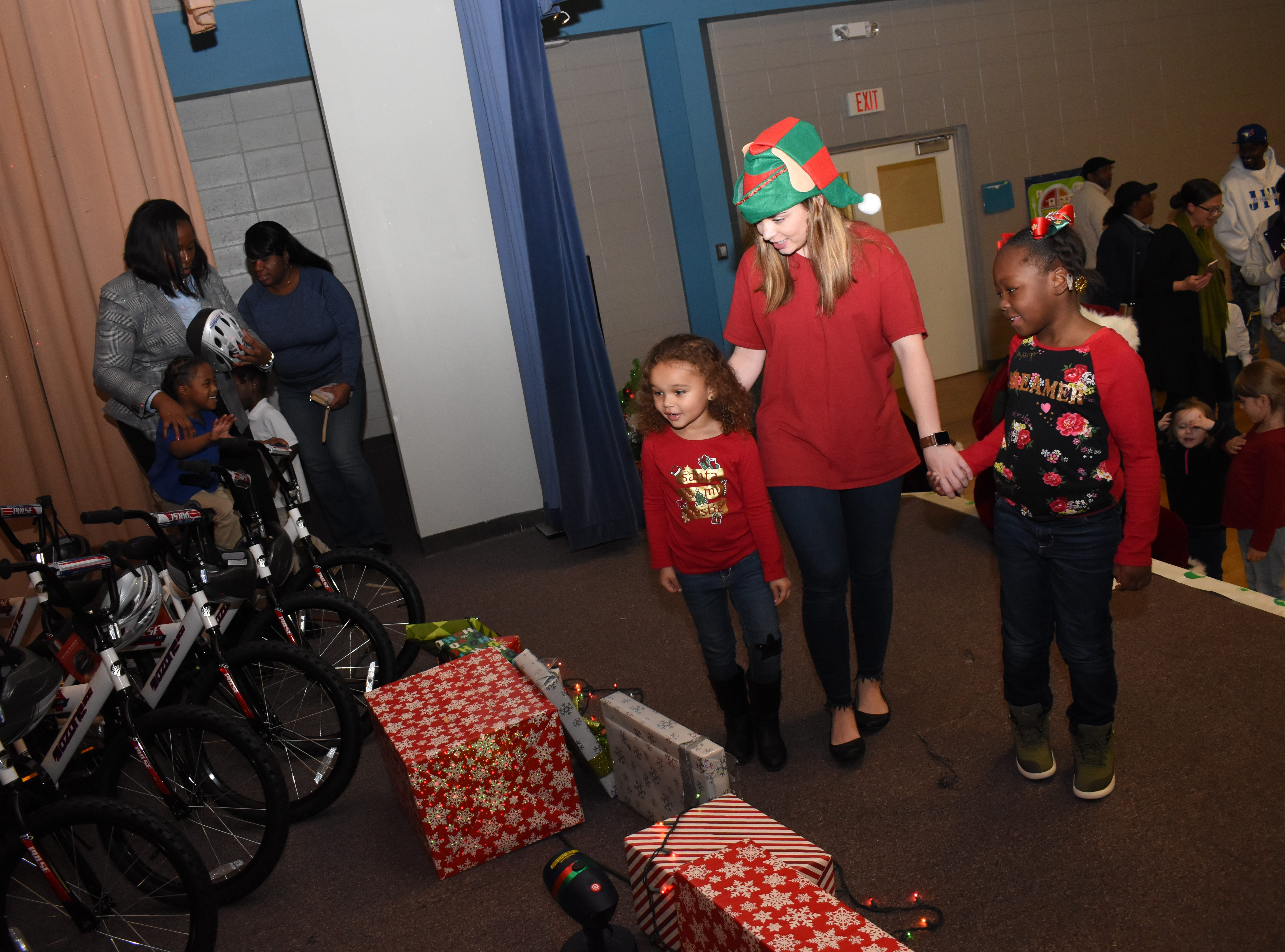 The Alexandria Academy Sports + Outdoors surprised 30 Mabel Brasher Montessori Elementary School students with bicycles and helmets Wednesday, Dec. 19, 2018. The Mabel Brasher students were among the 5,000 students in 16 states that were given bikes as part of Academy's holiday bike donation program. The bikes are a reward for children who have perfect attendance, academic performance, good behavior and may have a need for the gift.