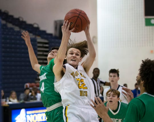 Brick's Brandon Bautista tries to steal a rebound away from a better positioned Ryan Schlosser during first half action.  Brick High School Boys Basketball vs Toms River North in Toms River NJ on December 18, 2018.