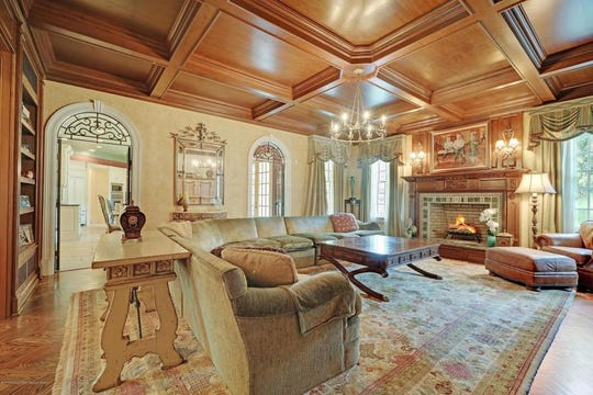The great room features amazing beamed ceilings and custom built-ins.