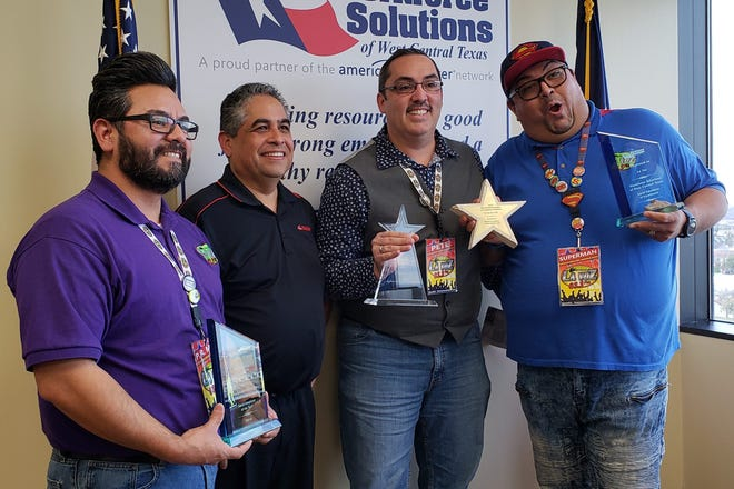 """""""P.R Mike,"""" Workforce Solutions of West Central Texas board chairman Samuel Garcia, Pete Garcia, owner of the La Voz radio station, and """"Superman"""" on Wednesday celebrate awards won by the station at the Workforce Solutions of West Central Texas' board meeting."""