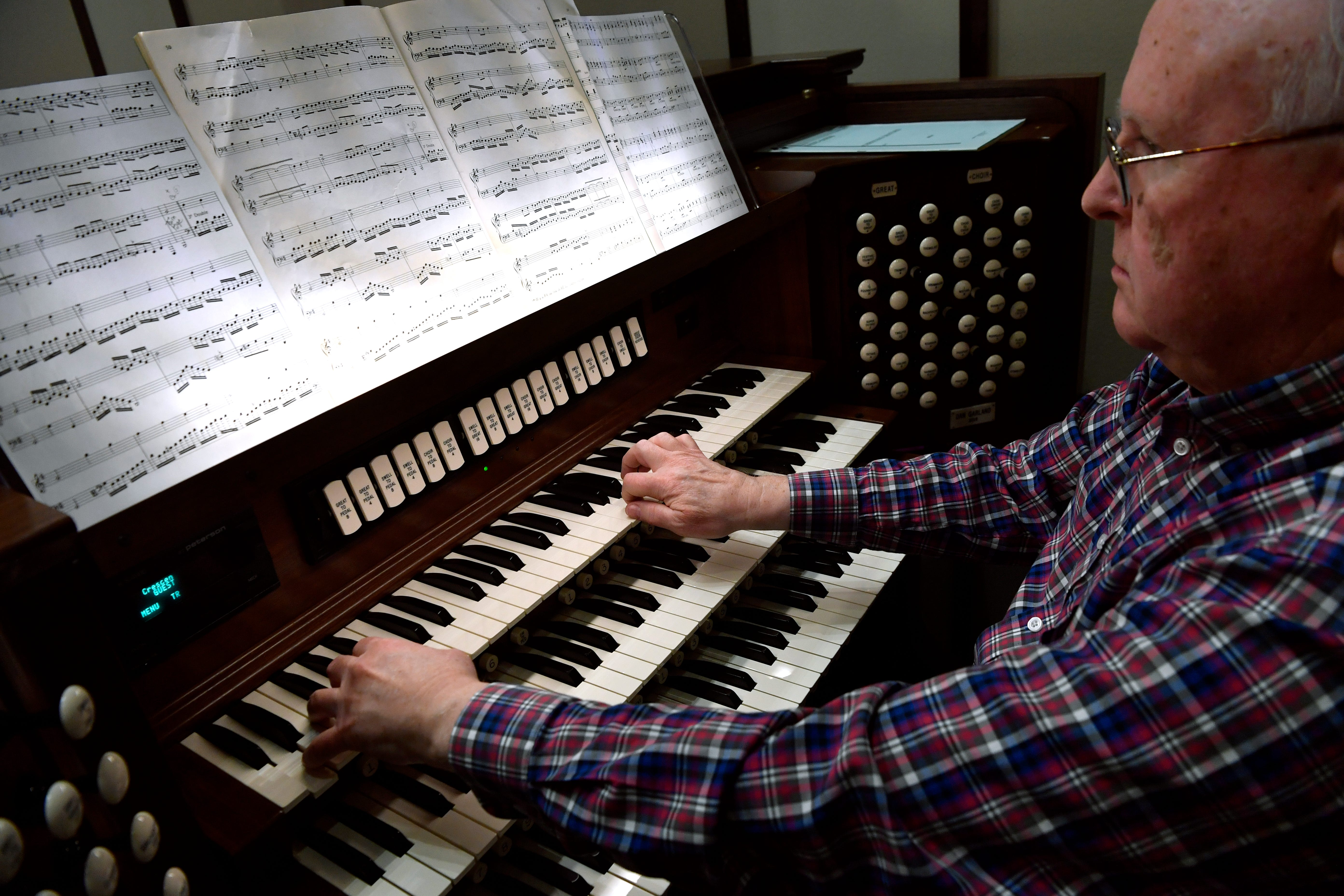 Larry Wolz rehearses on the new organ at First Central Presbyterian Church on Nov. 29. The church sanctuary just completed a major renovation, which included the $800,000 organ, paid for by a donor.
