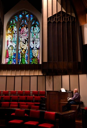 Larry Wolz rehearses Nov. 29 on the new 40-rank organ at First Central Presbyterian Church. The instrument, paid for by a $800,000 donation, features 2,440 pipes, about half of which are housed in the brown cabinet above his head, and was built by Dan Garland in Fort Worth.