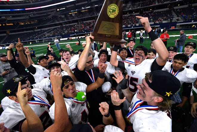The Strawn Greyhounds celebrate their Class 1A Division II six-man state title Wednesday Dec. 19, 2018 at AT&T Stadium.