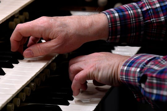 Playing on dual keyboards, Larry Wolz puts the new 40-rank organ at First Central Presbyterian Church through its paces Nov. 29.