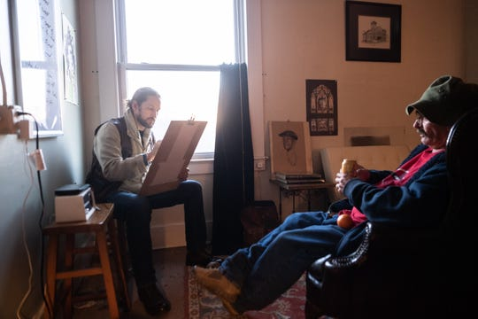 Christopher Holt works on sketching a portrait of Robert Stafford at the Haywood Street Congregation, Dec. 17, 2018. Holt is the artist creating a fresco which will appear in the sanctuary depicting Asheville as well as about 30 of the faces of marginalized people served by the church who suffer from mental illness, addiction and homelessness. After the Freedom from Religion Foundation challenged the $72,000 gift from the Buncombe County Tourism Development Authority, the congregation decided to move ahead with the fresco project on their own with sufficient donated funds to begin the work.