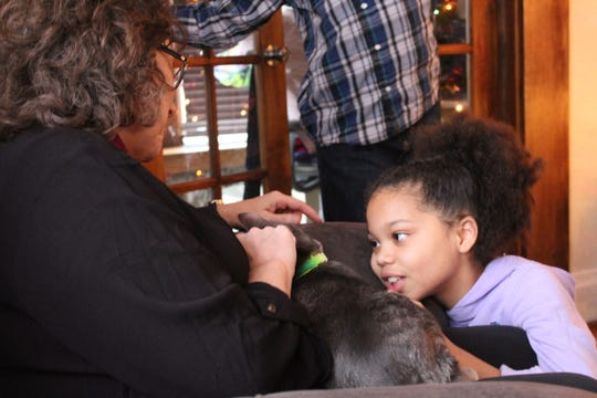 Kindra Hanson and her daughter Jadyn, 11, pet Louie the cat.