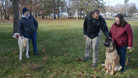 Mchael Delaware, left, with Moka, Jeff Breedlove and Debby Frayar and her dog, Cerberus, an English Mastiff at the proposed dog park.