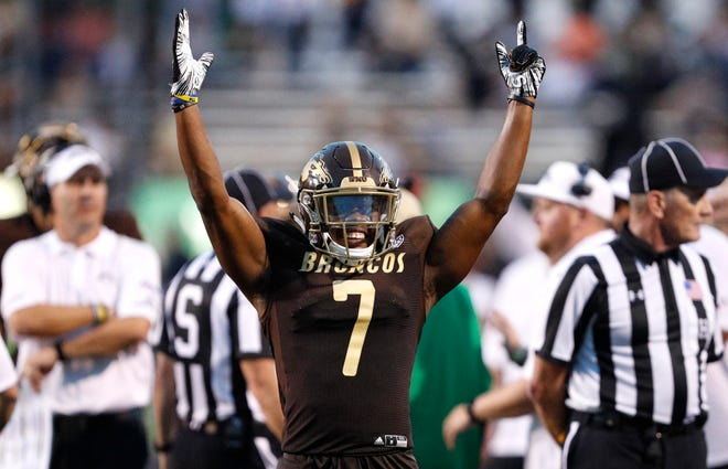 Western Michigan Broncos wide receiver D'Wayne Eskridge (7) celebrates after official review confirms his touchdown during the third quarter against the Syracuse Orange at Waldo Stadium.