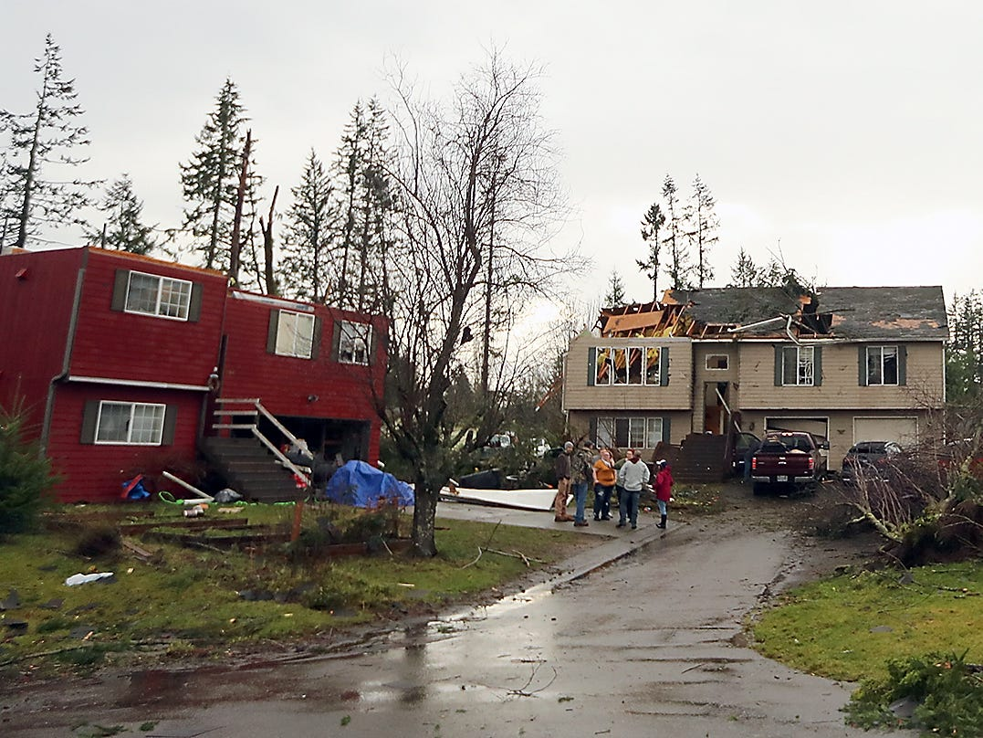 Heavily damaged homes on Tiburon Court in Port Orchard on Wednesday, December 19, 2018.