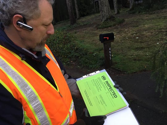 City and county officials went door-to-door early Wednesday performing safety inspections and advising affected homeowners of next steps.
