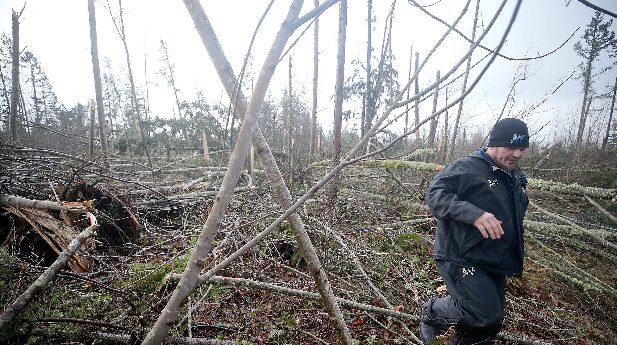 John Wagner walks through the downed trees behind Walmart after A tornado came through Port Orchard on the afternoon of Tuesday, December 18, 2018. The path was over Bethel near Walmart, and Safeway. He filmed the tornado from the Safeway.