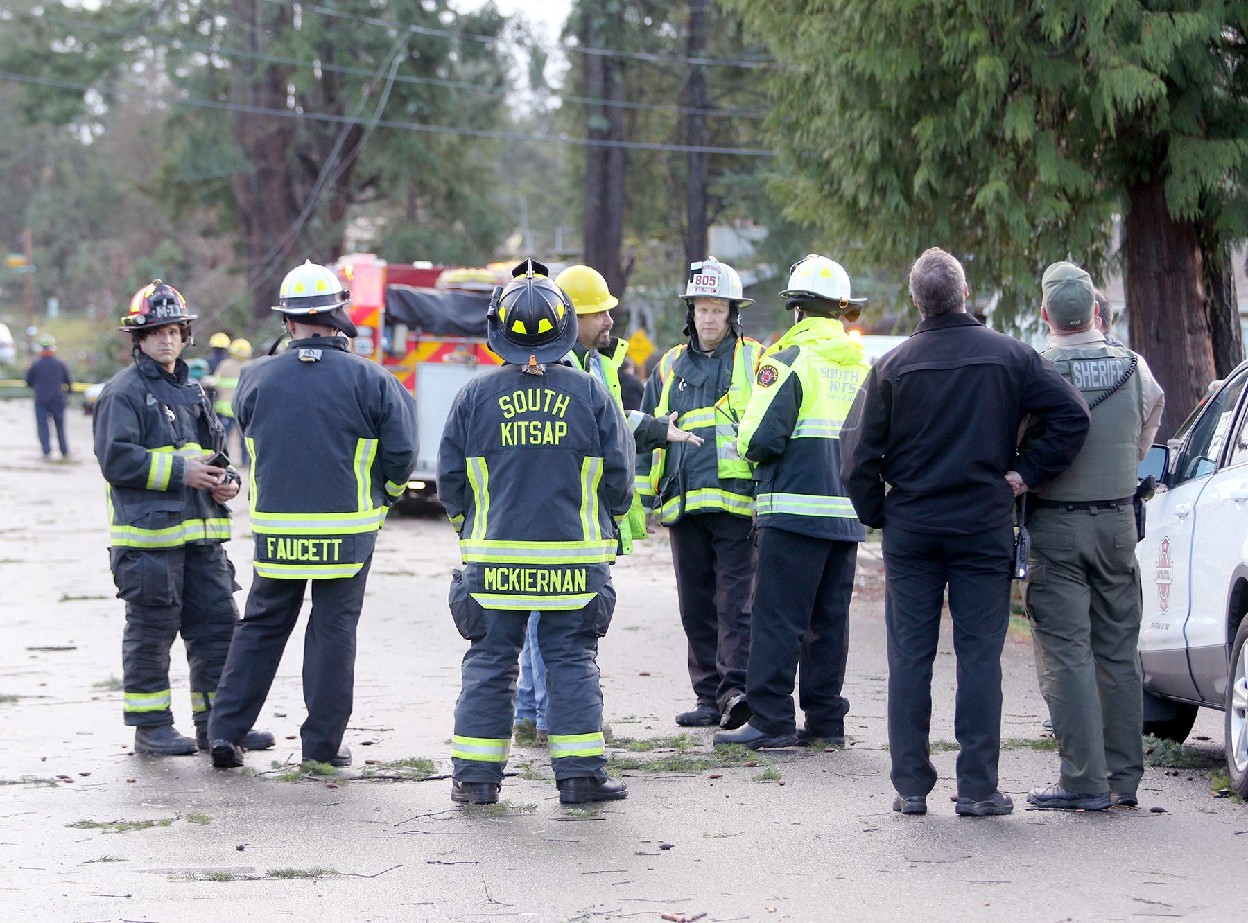 Emergency responders meet at the Harris Rd SE neighborhood after a tornado came through Port Orchard on the afternoon of Tuesday, December 18, 2018. The path was over Bethel near Walmart, and Safeway. He filmed the tornado from the Safeway.