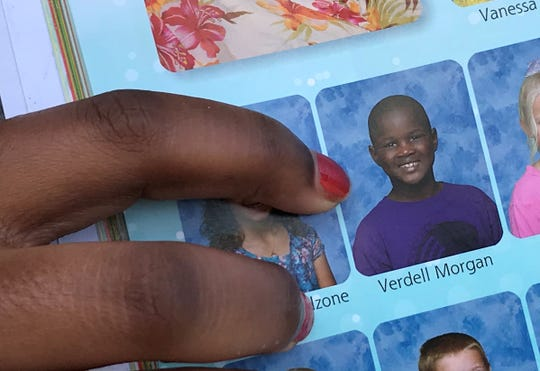 Aunt shows photo of Verdell Morgan