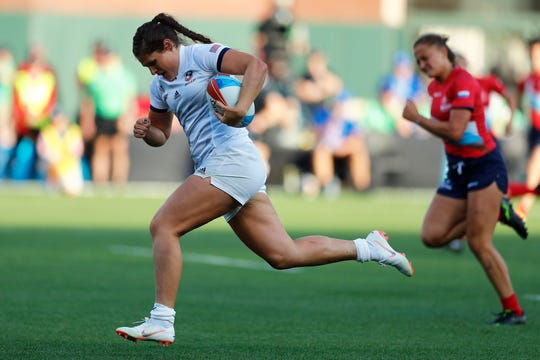 USA's Ilona Maher races away from the Russia defense on day one of the Rugby World Cup Sevens 2018 at AT&T Park in San Francisco on 20th July, 2018.