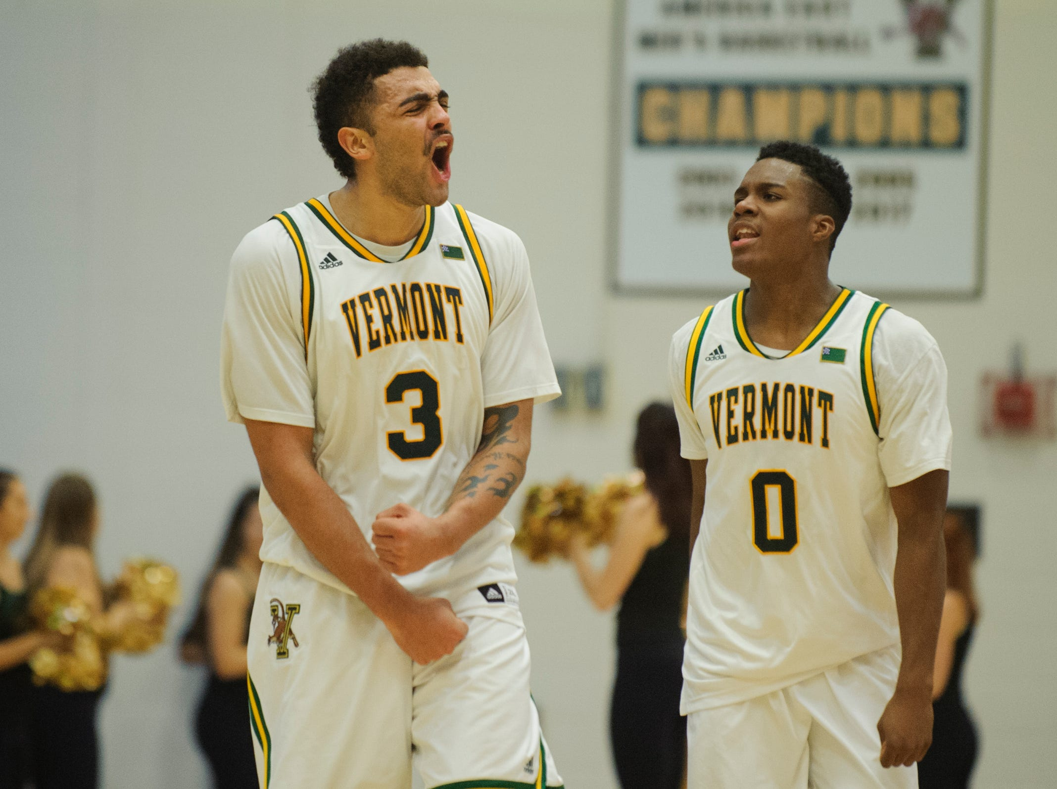 Vermont forward Anthony Lamb (3) and Vermont guard Stef Smith (0) celebrate the double overtime win during the men's basketball game between the St. Bonaventure Bonnies and the Vermont Catamounts at Patrick Gym on Tuesday night December 18, 2018 in Burlington.