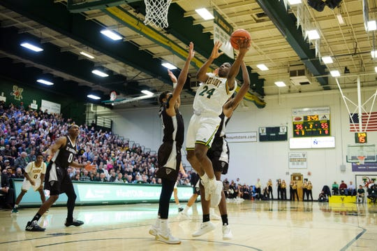 Vermont guard Ben Shungu (24) drive to the hoop for a lay up during the men's basketball game between the St. Bonaventure Bonnies and the Vermont Catamounts at Patrick Gym on Tuesday night December 18, 2018 in Burlington.
