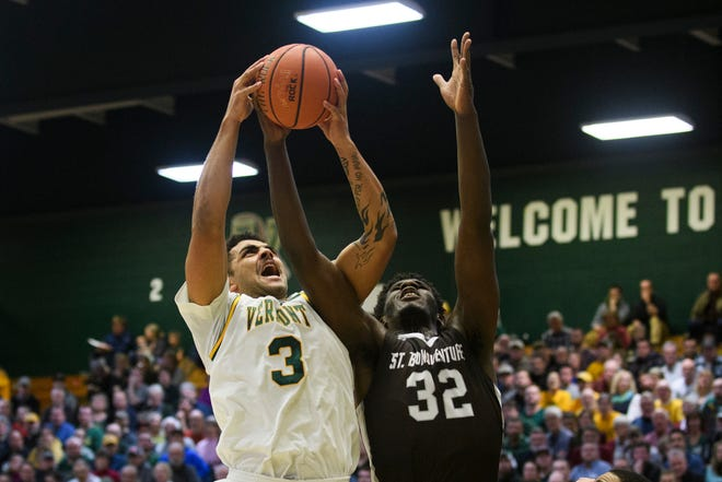 Vermont forward Anthony Lamb (3) fights for the rebound with St. Bonaventure's Amadi Ikpeze (32) during the men's basketball game between the St. Bonaventure Bonnies and the Vermont Catamounts at Patrick Gym on Tuesday night December 18, 2018 in Burlington.