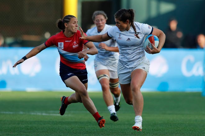 USA's Ilona Maher fends off the Russia defense on day one of the Rugby World Cup Sevens 2018 at AT&T Park in San Francisco on 20th July, 2018.