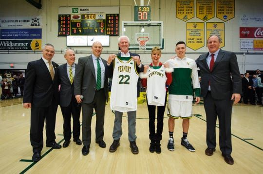 Rich Tarrant poses for a photo with a jersey given to him by head coach John Becker during a ceremony in which it was announced that Rich Tarrant had given a large donation to help build the new athletics facility during the men's basketball game between the St. Bonaventure Bonnies and the Vermont Catamounts at Patrick Gym on Tuesday night December 18, 2018 in Burlington.