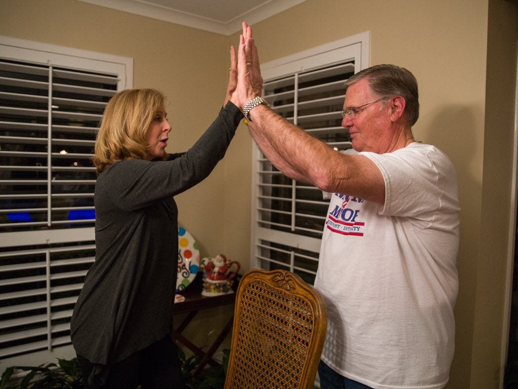 Joe McComb gets a high-five from outgoing City Council member Debbie Lindsey-Opel as complete unofficial elections returns show he garnered 59.99 percent of the Mayoral vote.