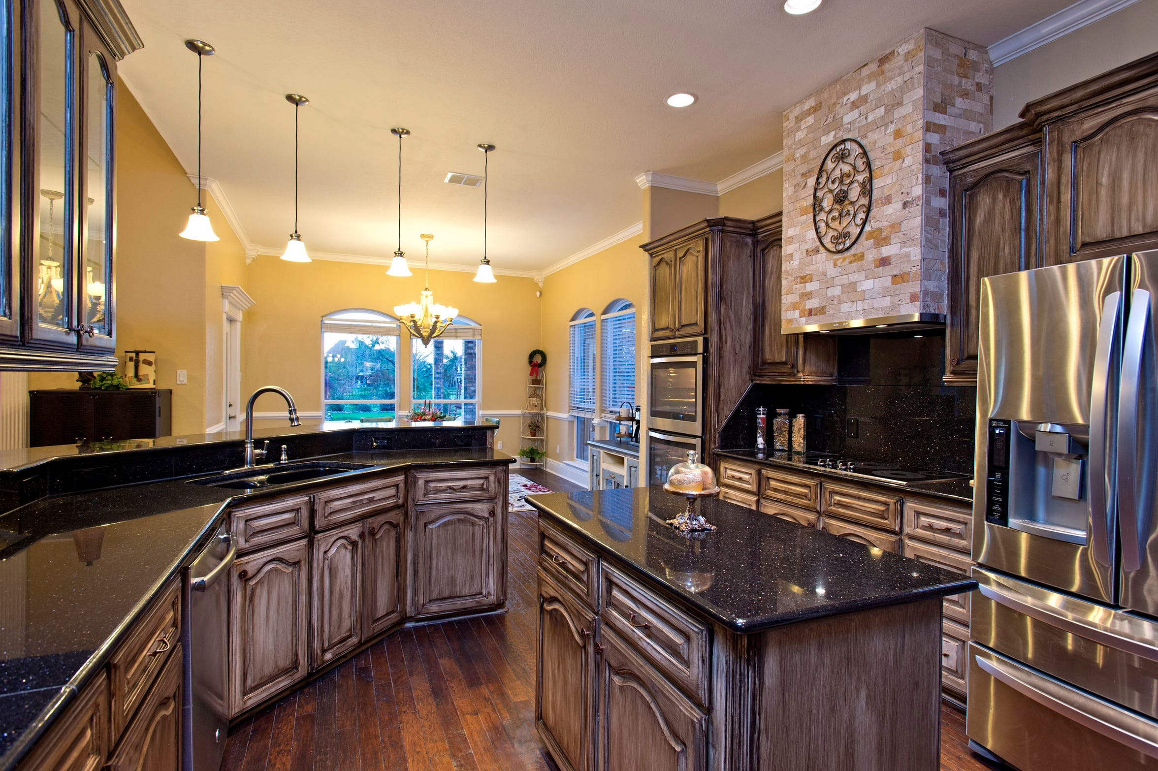 The kitchen along with the rest of the home has been remodeled with custom finished cabinetry,  hardwood flooring and top of the line stainless appliances.