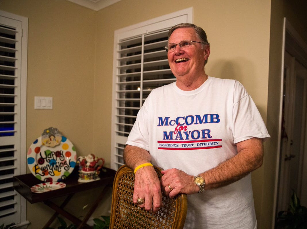 Joe McComb celebrates at his home after complete unofficial elections returns showed he garnered 59.99 percent of the mayoral vote.