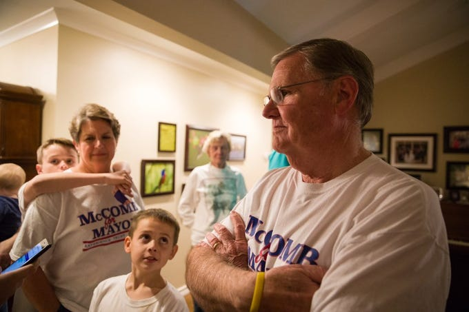 Joe McComb waits for election results with his family, including wife Mary McComb and grandsons Alex, 11 (left) and Kyle McComb. Complete unofficial elections returns show he garnered 59.99 percent of the mayoral vote.
