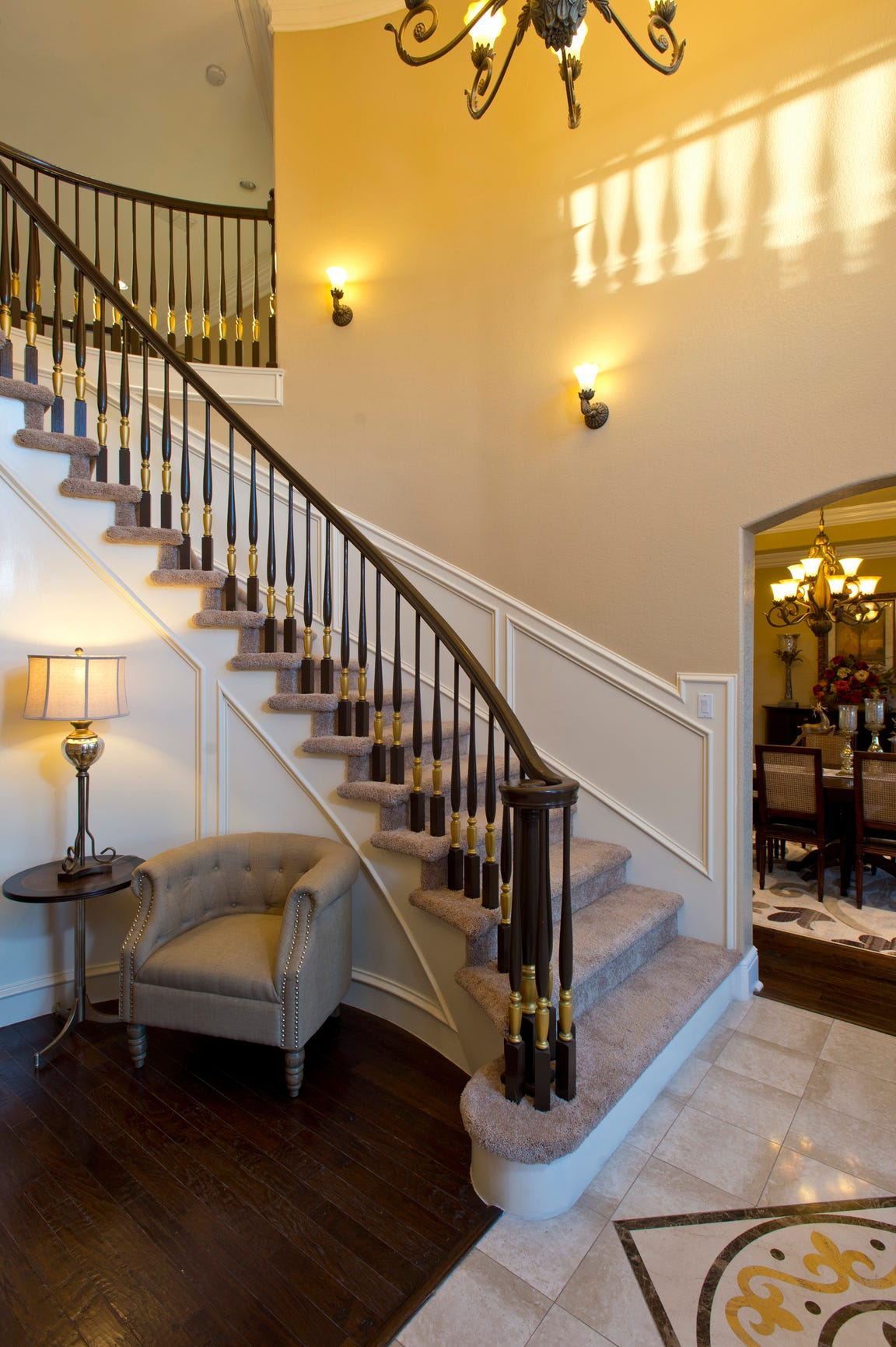 A beautiful curved staircase takes center stage in the entry foyer of the home.
