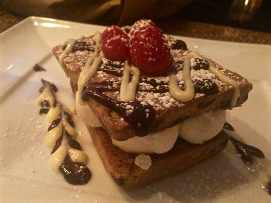The ice cream sandwich at Water and Wine in Watchung, which comes between two soft-baked chocolate chip cookies and is filled with graham cracker gelato, then topped with raspberries, chocolate sauce and powdered sugar. o)